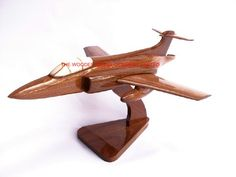 "A beautiful hand carved desktop model of the Bucaneer. The model has been carved from solid mahogany. The model comes boxed and is simple to assemble. The wings, tail fins and stand simply slot into pre-drilled holes on the body of the aircraft. No glue required. Size H 8"", L 14"", W 11"". Visit our website at http://www.thewoodenmodelcompany.co.uk to view the full range of our models."