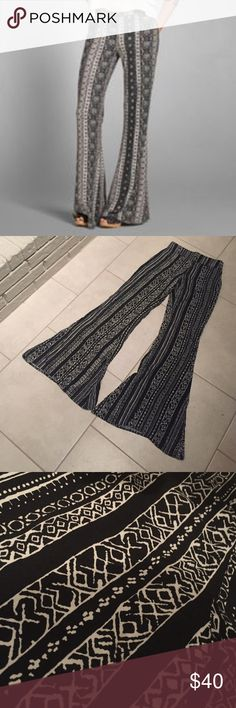 Hollister Patterned Flare Pants A head-turning piece with a flare fitting through the legs, featuring a stretchy waistband. Never worn. Hollister Pants Boot Cut & Flare