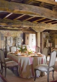 Stone walls and exposed beams combined with elegant French style dining chairs and grain sack inspired table cloth. Description from pinterest.com. I searched for this on bing.com/images