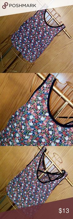 Chloe K floral print crop top Chloe K floral print crop top In size small In great condition Very lightweight, semi see through Beautiful floral print design with black straps across the back. Chloe K Tops