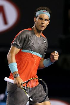 Rafael Nadal after hitting a clean winner while competing at the 2014 Australian Open. Battling back pain and severe blisters on his hand throughout the tournament, he was eventually stopped in the final by Stanislas Wawrinka, who won the title 6-3 6-2 3-6 6-3.