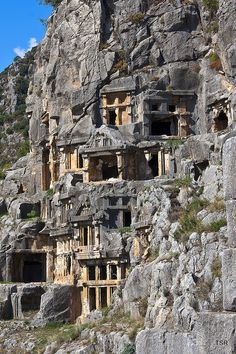 the lycian rock tombs of Myra, Turkey - Although most of the tombs are plain today, Charles Fellows tells that upon his discovery of the city in 1840 he found the tombs colourfully painted red, yellow and blue. The entire cliff face must have once been a bright riot of colour.