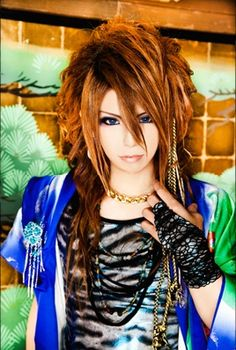 Tokai Junji (遠海准司) is the drummer of Kiryu, a Japanese Visual Kei band. He is also in their alter-ego band, My Dragon as Pretty JuJu. His image color is blue.