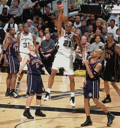 Tim Duncan dunks during Game 1 of the NBA Finals between the San Antonio Spurs and New Jersey Nets on June 4, 2003 in San Antonio.