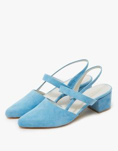 This pair of robins egg suede mules is a must-have accessory for spring.