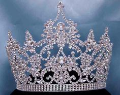 Continental Rhinestone Crystal Crown Tiara Magnificent Rhinestone Crown Tiara, made with the finest rhinestones and silver plated metal. Incorporated in this design are the stones in different sizes.