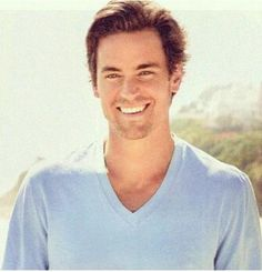 He smiles his 'I'm only 27' carefree smile :-) Perfect picture for that role!