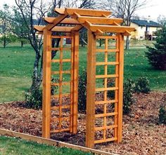 simple arbor (not necessarily this one!) over the front entrance sidewalk by garage
