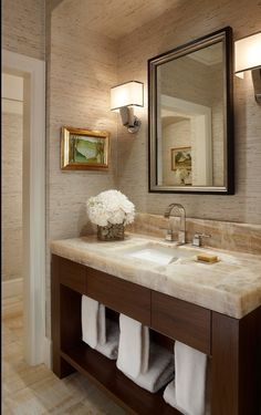 grass cloth, onyx slab, etc. in a small bathroom