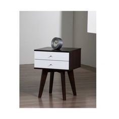 Bring a little mid-century modern style into your bedroom with this uniquely designed rubberwood #nightstand. A wenge frame surrounding white drawers draws much ...