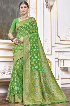 Parrot Green viscose saree with parrot green viscose blouse. Embellished with woven zari work. Saree with Sweetheart Neckline, Elbow Sleeve. It comes with unstitch blouse, it can be stitched to 32 to 58 sizes. #weddingsaree #weddingwearsaree #festivalwear #partywearsaree