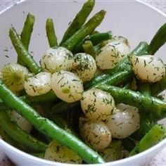 Pearl onions are caramelized, then quickly sauteed with green beans. The combination of flavors is what makes this dish a hit!