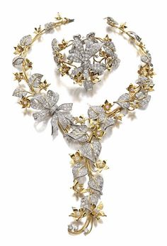 Gold and Diamond Suite, designed by George Headley, Los Angeles, Necklace, Paul Flato (1939-41), 602 diamonds, total weighing 30.10 cts; Bracelet , Sol Laykin (1939-45), 283 diamonds, total weighing  14.15 cts, Norma Shearer chose the ivy necklace which had been featured in an editorial in Vogue in 1941.