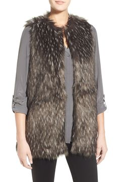 A long vest of speckled faux fur adds a luxurious feel to even the most simplistic fall ensembles.