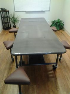 """Custom built steel table for Global Disposal in La Mesa, Ca.  Table built by Brad Allen Welding Company. www.bradallenweldingco.blogspot.com.  Frame built of 1-1/2"""" round steel tubing. Top is 16ga. Cold rolled sheet metal. Paint is metallic dark grey with clear coat. Seats are custom built by brad allen welding and then upholstered by south bay upholstery."""