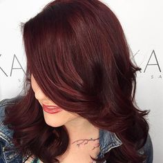 Headed out on the #town for a glass of wine with #friends #tonight?We are #crushing hard on this mulled wine #haircolor and loose #curls. Featured #hairarist: @karmahairsalon