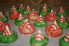 Candy Cane Blossoms AKA Christmas Kiss Cookies   (source:http://www.bakedperfection.com/2010/12/candy-cane-blossoms.html)