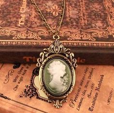 cameo on unusual green background, probably stone