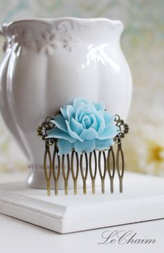 Baby Blue Rose Flower Hair Comb, Light Blue Wedding Hair Accessory, Bridal Hair Comb, Bridesmaid Gift, Country Wedding, Something Blue by LeChaim on Etsy https://www.etsy.com/listing/124408861/baby-blue-rose-flower-hair-comb-light