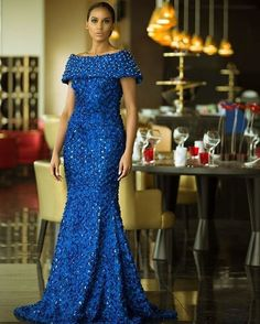 Dinner gowns bring out the very spice, gentle and lady-like aspects of a woman. African celebrities and fashionistas have already rocked the best Ankara dinner gowns, so we gonna get a lesson from them. African Lace Styles, African Lace Dresses, African Dresses For Women, African Print Fashion, Africa Fashion, African Attire, African Fashion Dresses, African Wear, African Women