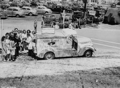 Good Humor Ice Cream truck with the salesman at Lockheed Air Terminal during World War II. His truck advertises that he sells War Bonds. Coralie Hewitt Tillack Collection.