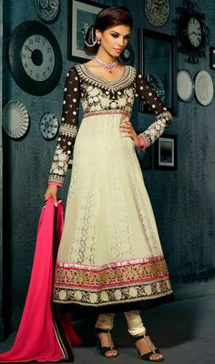 Look stunningly beautiful being dolled up in this black and cream georgette embroidered Anarkali suit. The brilliant dress creates a dramatic canvas with astounding patch, resham and stones work. #PartyWearDress