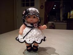 "Berenguer 5"" Baby Dolls - White crochet/black trim dress #54  More can be seen on Pinterest under Jana Langley Berenguer 5"" Dolls with crocheted outfits"