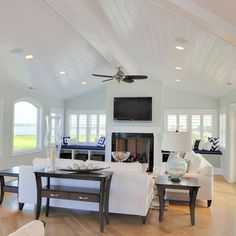 plank ceiling with beam and can lights