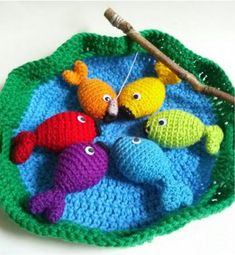 Enjoy your childhood all over again with this crocheted Rainbow Fish Game.