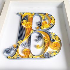 """Quilled """"B""""."""