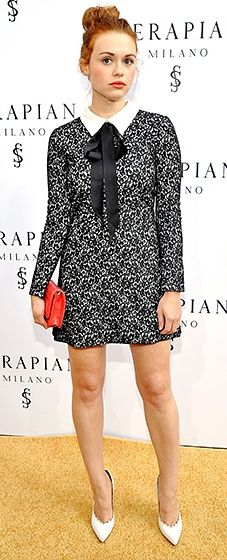 The Teen Wolf actress sashayed onto the scene in a long-sleeved, lace ERIN Erin Fetherston dress with schoolgirl details, plus a red Serapian clutch and scalloped heels.