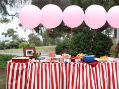 red white stripe skirted table for circus theme.