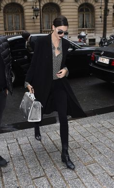 March 4, 2016 Jenner hit the streets at Paris Fashion Week looking every bit the high-fashion model. We don't know which we're loving more: that surprisingly wearable dark lipstick or her silver 'Diorever' bag.