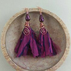 I'm in love with this beautiful dark purple recycled sari silk ribbon.  These ribbon tassel earrings are a great way to follow a trend while keeping your style unique!