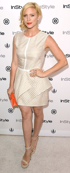 Brittany Snow wearing a striped white peplum Lela Rose dress (paired with an Oroton clutch).