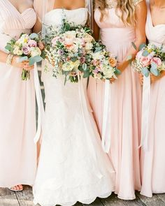 Crushing on this #classic and #romantic look with the bride in lace and her #bridesmaids in beautiful blush dresses! Found on @classic_bride. Image: @JoPhoto by aislesociety