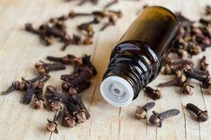 CLOVE OIL uses are incredibly impressive, ranging from improving blood circulation and reducing inflammation to helping acne and boosting gum health. One of the best-known clove oil uses is to reduce the pain associated with dental problems. Clove Oil Uses, Clove Oil Benefits, Health Benefits, Health Tips, Natural Treatments, Natural Remedies, Flu Remedies, Remedies For Tooth Ache, Parasite Cleanse