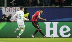 Manchester United striker Anthony Martial side-foots the ball past Wolfsburg goalkeeper Diego Benaglio early in the first half