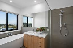 The Kilcunda bathroom features a freestanding bath with views of the ocean into the distance. The 6 starts WELS rated plumbing fittings control the flow of water, saving up to 14, 500 litres of water in an average home each year. Photographer @coastalsnaps coast #construction #australianarchitecture