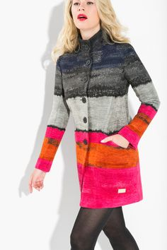 This coat from our AW15 Christmas Collection is so striking that no-one will even notice what you wear underneath! Made of a soft blend material with an A-line cut this coat will keep you cozy chic. It's blue, gray, pink and orange colors will complement anyone!  #XmasByDesigual