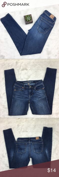 American Eagle Super Skinny Jeans American Eagle Super Skinny blue jeans. Size 0 long (28' inseam). GUC. Has two small spots on the front tights one on each leg. And a white spot on the back next to pocket. Not extremely noticeable when worn.  ❌No trades ❌ Modeling ❌No PayPal or off Posh transactions ❤️ I 💕Bundles ❤️Reasonable Offers PLEASE ❤️ Bundle & SAVE❗️❗️ American Eagle Outfitters Jeans Skinny
