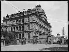 View from the Royal Botanic Garden of the Chief Secretary's Building (originally the Colonial Secretary's Office), c.1900.  This sandstone building, designed by colonial architect James Barnet, is on the corner of Bridge, Macquarie and Phillip Streets.  Powerhouse Museum.