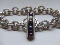 Encased T-Bar bracelet.  Peacock and white pearls encased in brushed sterling silver.    Elizamar jewellery by Jody Cornett