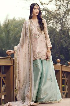 Look effortlessly chic in this embroidered Tissue shirt with flared sleeves and adorned with hand embroidered Dabka, comes with Banarsi pants and slip. Pakistani Fashion Party Wear, Party Wear Lehenga, Pakistani Bridal Dresses, Pakistani Dress Design, Party Wear Dresses, Pakistani Outfits, Bollywood Fashion, Indian Fashion, Indian Outfits