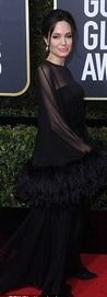 Angelina, 42, looked nothing short of sensational in a black gown, keeping with the event's color scheme, with sheer neckline and feathered sleeves.