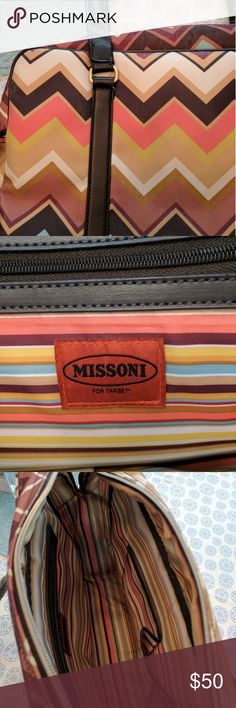 Missoni for Target bag Missoni for Target bag in like new condition. Has zipper closure and long strap. Overall very clean. Only flaw is some knicks as shown in last picture. Dimensions are 16 x13 inches with 5 inches across the bottom. Can be travel,  tote or laptop bag. Missoni Bags Totes