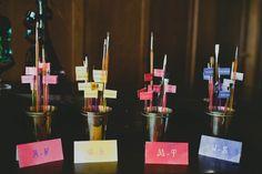 paintbrush escort cards // photo by Sarah McKenzie // http://ruffledblog.com/pablo-picasso-wedding-inspiration