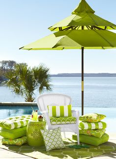 Lake living at its' finest...love the green color of the outdoor deck furnishings.