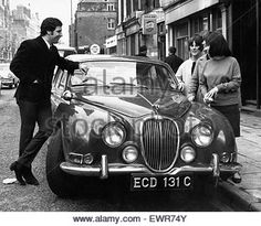 Welsh singing star Tom Jones shows off his new Jaguar car to three young fans in London today. 27th April 1966 - Stock Photo