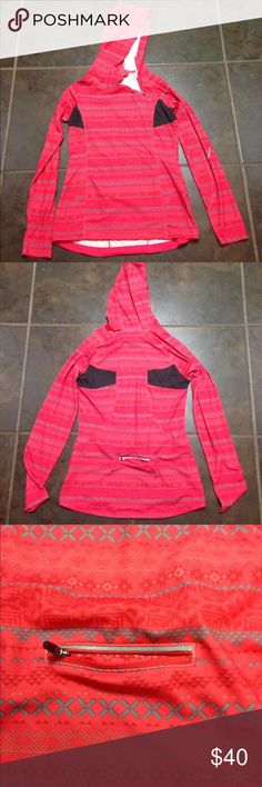 Beautiful pinkish red patterned pullover. NWOT This pullover has a unique half side zip, ventilation under the arms and a handy pocket in the back. Never worn. NWOT. *Not Lululemon, just needed exposure.* lululemon athletica Tops